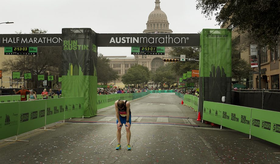 Under an early morning fog and in the shadows of the Texas Capitol thousands of runners participated in the Austin Marathon and Half Marathon Sunday February 16, 2014. Men's racer Jim Needway stops after crossing the finish line in exhaustion. RALPH BARRERA / AMERICAN-STATESMAN